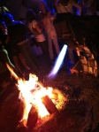 Campfire party with fire-spitting creature